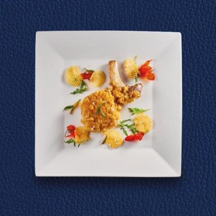 Cutlet of breaded veal with Goffredo potatoes and semi-dried tomatoes